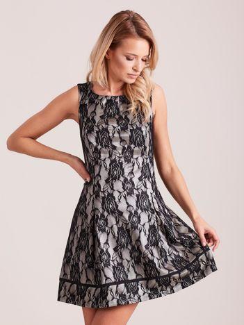 Koronkowa rozkloszowana sukienka czarna