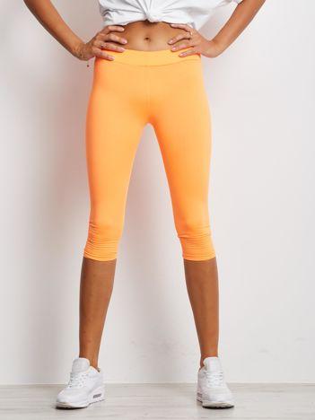Krótkie lekko ocieplane legginsy fitness fluo pomarańczowe
