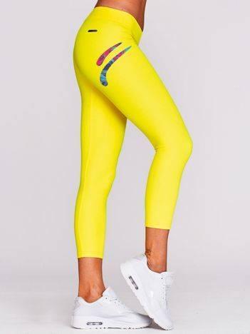 Legginsy do biegania z kolorowym logo na udzie żółte