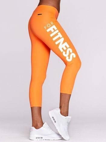 Legginsy do fitnessu z jasnym nadrukiem FITNESS fluo pomarańczowe