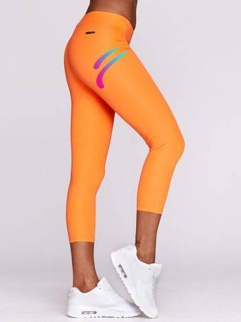 Legginsy na siłownię z nadrukiem logo fluopomarańczowe