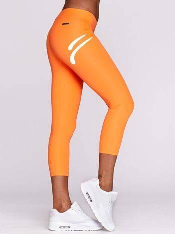 Legginsy sportowe z kontrastowym emblematem fluo pomarańczowe