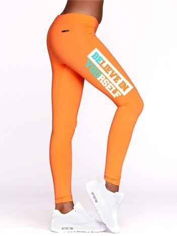 Legginsy sportowe z nadrukiem BELIEVE IN YOURSELF fluopomarańczowe