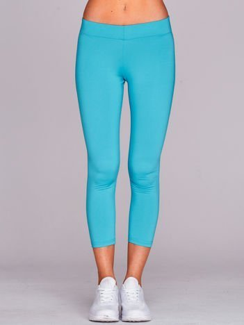 Lekko ocieplane legginsy fitness o długości 3/4 jasnoturkusowe