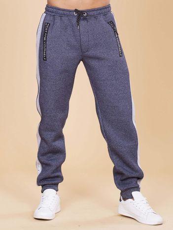 Męskie spodnie dresowe ocieplane granatowe