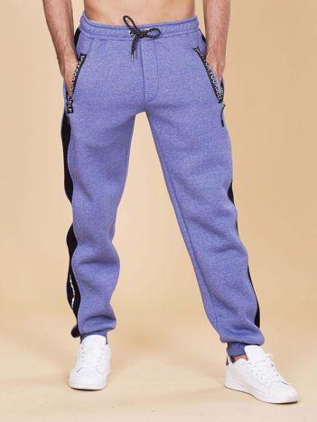 Męskie spodnie dresowe ocieplane niebieskie