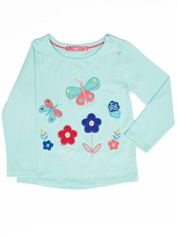 Miętowa bluzka dla dziewczynki z kolorowymi naszywkami