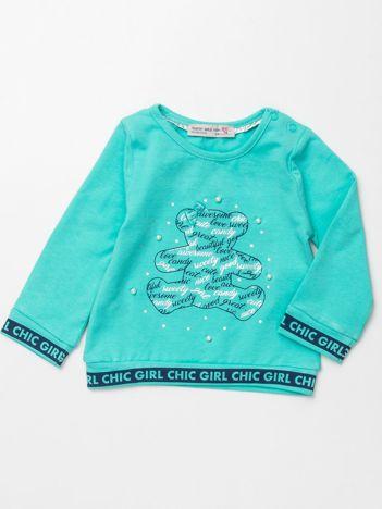Miętowa bluzka dla dziewczynki z perełkami