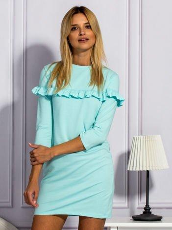 Miętowa sukienka z falbankami