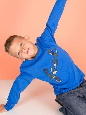 Niebieska bawełniana bluzka dziecięca z moro aplikacją