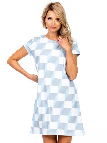Niebieska sukienka w geometryczne wzory