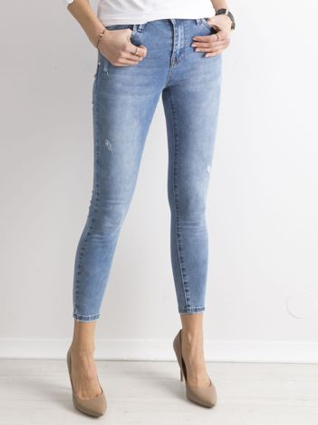 Niebieskie damskie spodnie jeansowe
