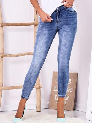 Niebieskie dopasowane jeansy z kokardkami