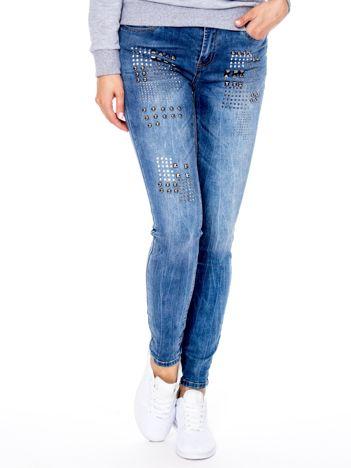 Niebieskie jeansy damskie z aplikacją
