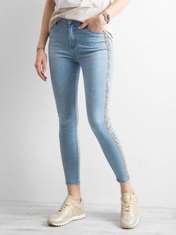 Niebieskie jeansy z błyszczącym lampasem