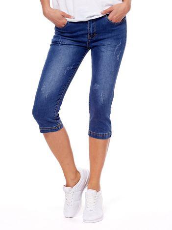 Niebieskie jeansy z przetarciami PLUS SIZE