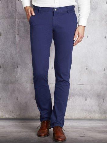 Niebieskie lekko dopasowane spodnie męskie
