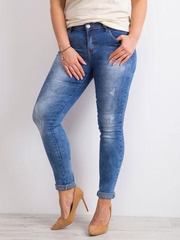 Niebieskie przecierane jeansy PLUS SIZE