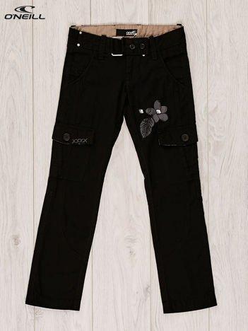 O'NEILL Czarne spodnie dla dziewczynki z kwiatowym motywem
