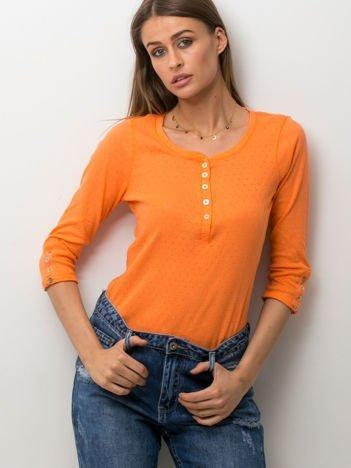Pomarańczowa bluzka w drobny ażurowy wzór z guzikami