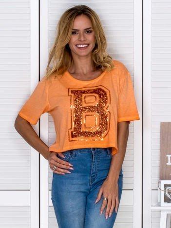 Pomarańczowy t-shirt z cekinową literą B