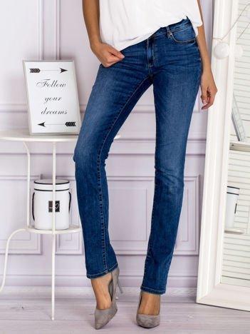 Proste spodnie jeansowe z delikatnymi przetarciami niebieskie