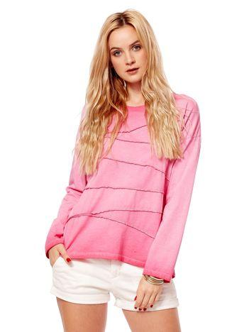 Różowa bluzka z asymetryczymi przeszyciami