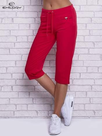 Różowe spodnie capri z wszytymi kieszonkami