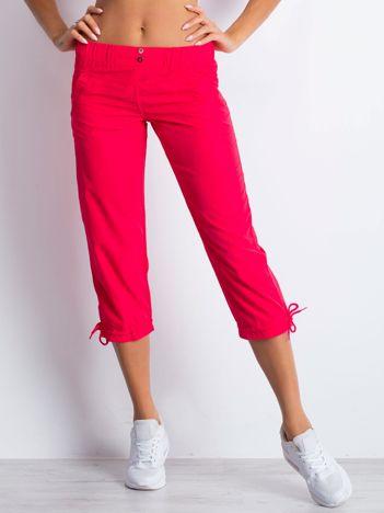 Różowe spodnie sportowe capri z guzikami