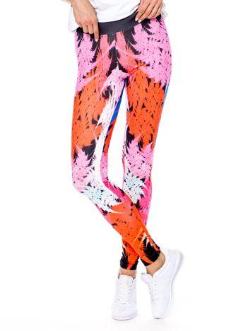 Różowo-pomarańczowe legginsy we wzory