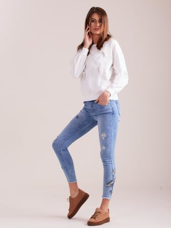 SCANDEZZA Biała bluza z aplikacją