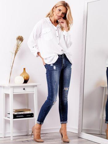 SCANDEZZA Niebieskie jeansy z przetarciami