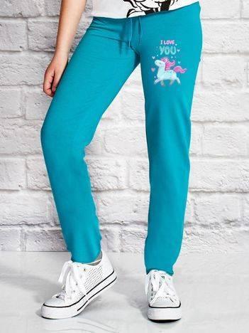 Spodnie dresowe dla dziewczynki z kolorowym kucykiem zielone