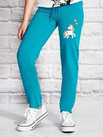 Spodnie dresowe dla dziewczynki z motywem jednorożca zielone