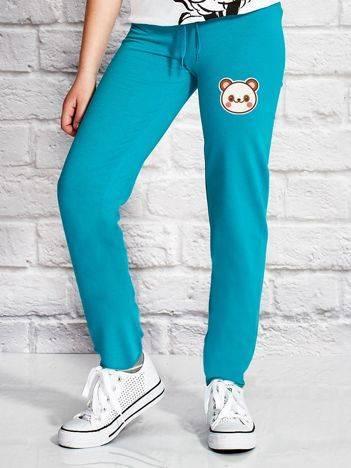 Spodnie dresowe dla dziewczynki z motywem pandy zielone