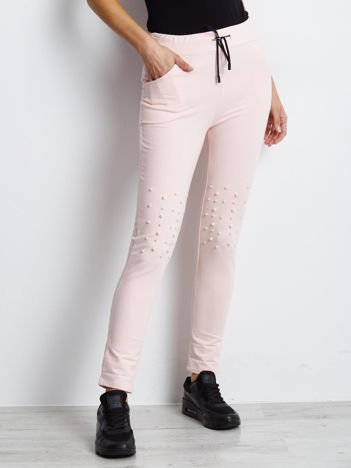 Spodnie dresowe jasnoróżowe z troczkami i perełkami