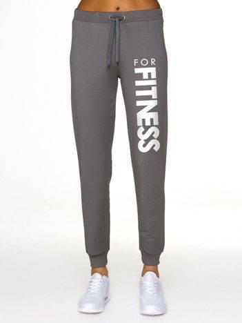 Spodnie dresowe z jasnym nadrukiem z przodu ciemnoszare