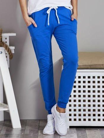 Spodnie dresowe ze ściągaczami i troczkami niebieskie