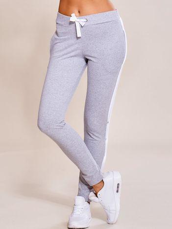 Szare spodnie dresowe z rozpinanymi nogawkami na napy