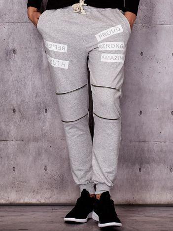 Szare spodnie dresowe z suwakami i napisami