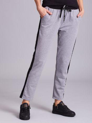Szare spodnie z lampasami