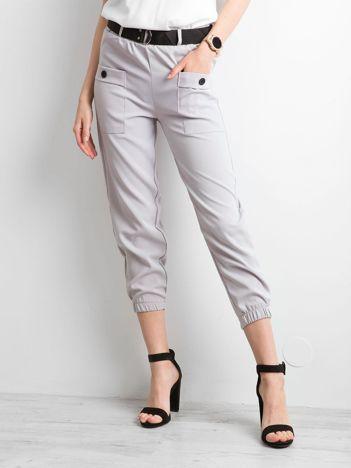 Szare spodnie ze ściągaczami
