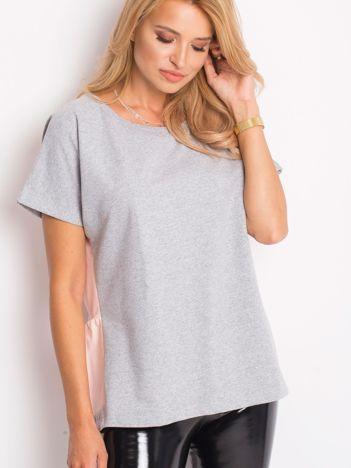 Szaro-różowa bluza oversize z krótkim rękawem i falbanką