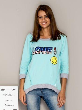 Turkusowa bluza z cekinowym napisem LOVE i kokardami z tyłu