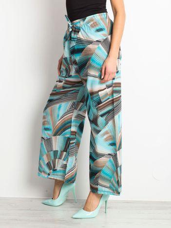 Turkusowo-beżowe spodnie Perfume