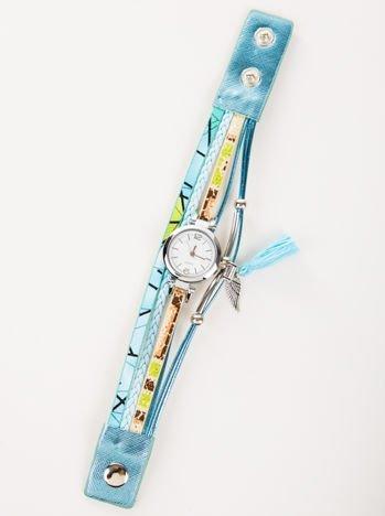 Turkusowy zegarek damski  z zawieszkami chwost i skrzydło