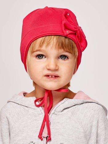 Wiązana czapka dziewczęca z ozdobną kokardą koralowa