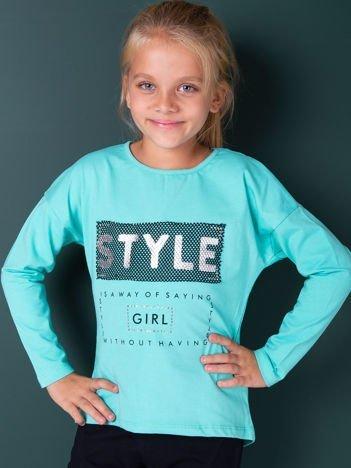 Zielona bluzka dla dziewczynki z napisem i aplikacją