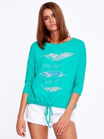 Zielona bluzka z piórkami