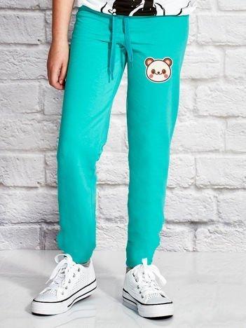 Zielone spodnie dresowe dla dziewczynki z pandą